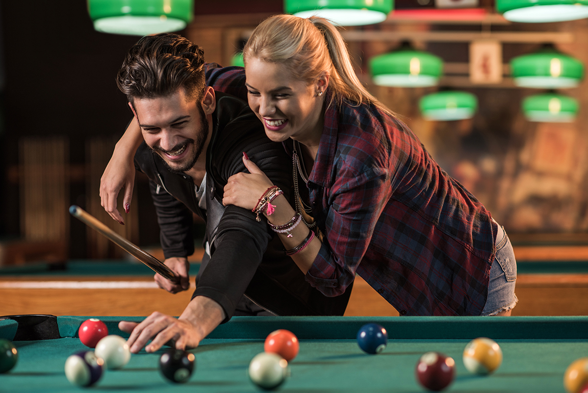 Man and woman playing pool